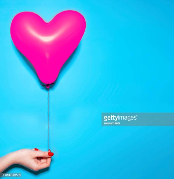 blue heart shaped balloon - pop art stock pictures, royalty-free photos & images