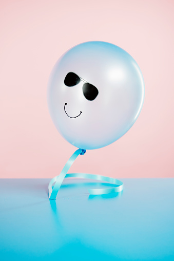blue helium balloon with smiling faces floating - gettyimageskorea