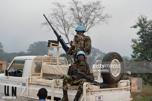 UN Blue Helmet peacekeepers look on as they arrive on January 6 2017 in Bouake where soldiers demanding more pay and housing rose up earlier in the...