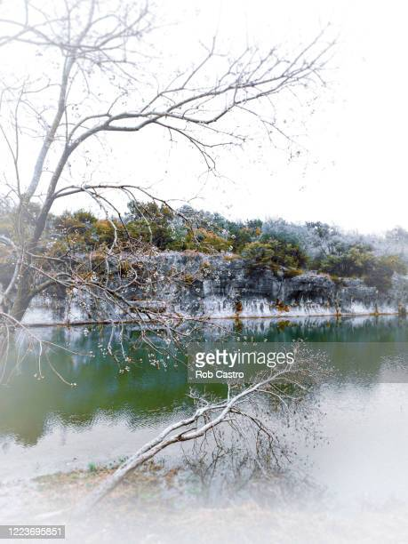 blue hole in the wintertime - rob castro stock pictures, royalty-free photos & images