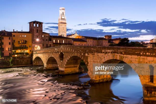 blue hour at ponte pietra, verona, italy - verona foto e immagini stock