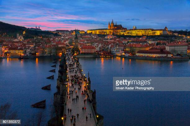 blue hour at prague, czech republic - charles bridge stock photos and pictures