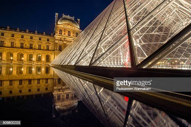 Blue hour at The Louvre museum in the evening with the reflection.