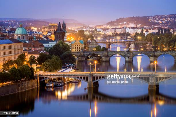 blue hour, bridges, vltava river, prague, czechia - charles bridge stock photos and pictures