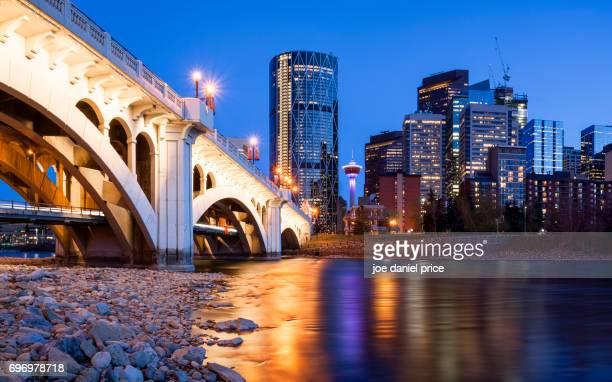 blue hour, centre street bridge, bow river, calgary, alberta, canada - calgary alberta stock pictures, royalty-free photos & images