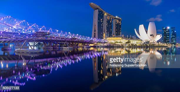 CONTENT] Blue hour moment at Marina Bay with the Famous Landmark Buildings such as Helix Bridge Marina Bay Sands and Lotus Art and Science Museum...