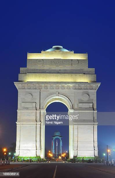 blue hour on india gate... - india gate stock pictures, royalty-free photos & images