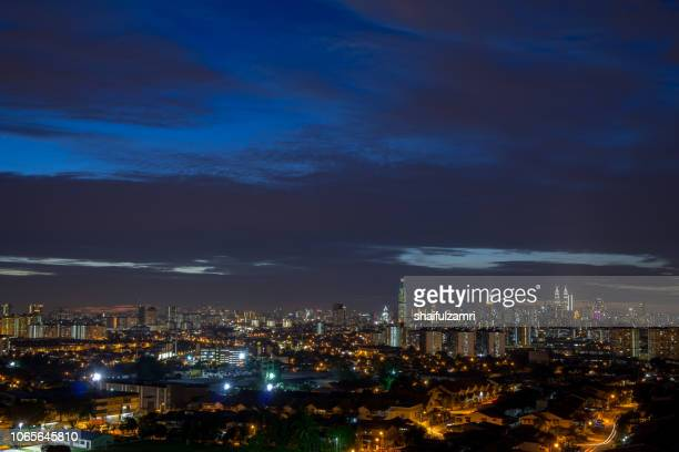 Blue hour over Kuala Lumpur, capital of Malaysia. Its modern skyline is dominated by the 451m tall KLCC, a pair of glass and steel clad skyscrapers.