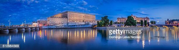 Blue hour panorama of the old and new seats of power in Stockholm. The Royal Castle and the Riksdag side by side.
