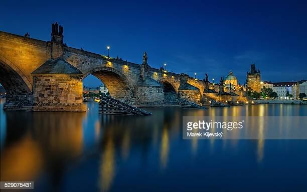 blue hour reflection - charles bridge stock photos and pictures