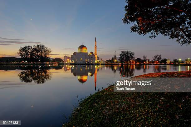 blue hour with floating mosque - floating mosque stock pictures, royalty-free photos & images