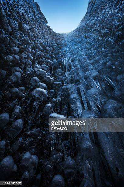 Blue ice caves in Jökulsárlón glacier. Iceland. North Atlantic Ocean.