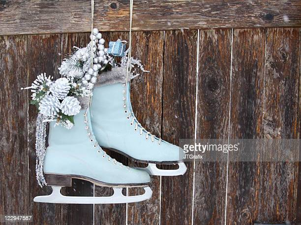 blue ice skates hanging on fence - ice skate stock pictures, royalty-free photos & images