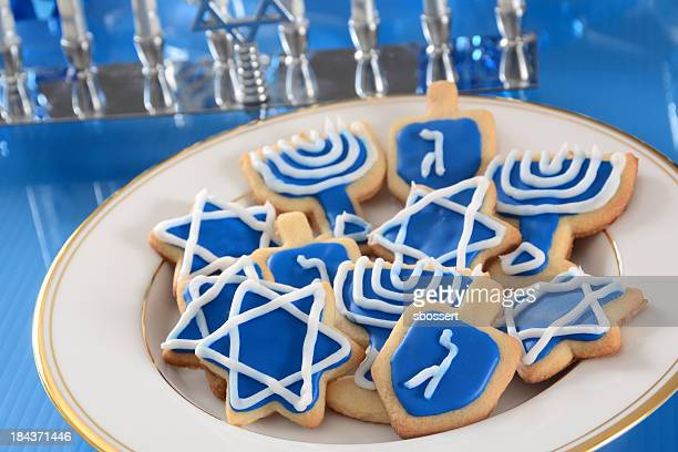 blue iced cookies for hanukkah - dreidel stock photos and pictures