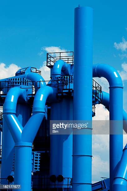 Blue Industrial Installations Against Sky