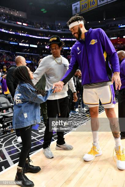 Blue Ivy Carter and Jay-Z greet JaVale McGee after a basketball game between the Los Angeles Clippers and the Los Angeles Lakers at Staples Center on...