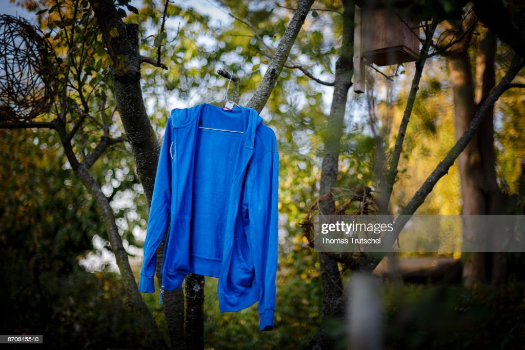 A blue jacket hangs on a tree for air drying on October 17, 2017 in Berlin, Germany.