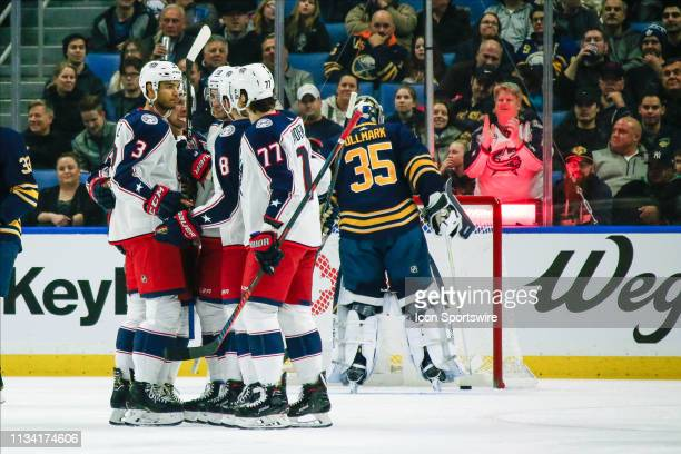 Blue Jackets and fan celebrates goal by Columbus Blue Jackets center PierreLuc Dubois during the Columbus Blue Jackets and Buffalo Sabres NHL game on...