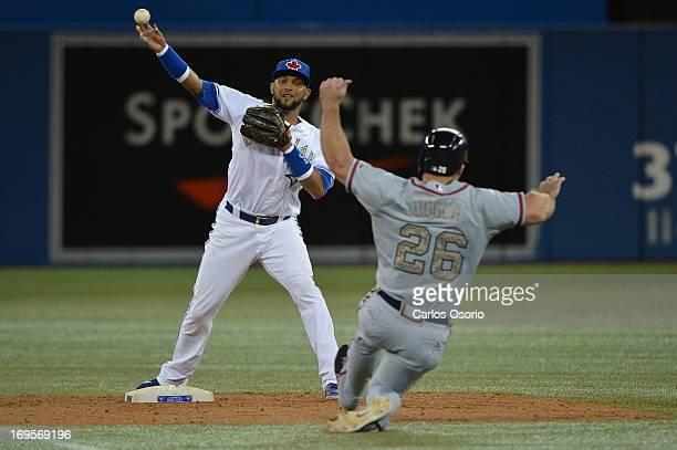 TORONTO ON MAY 27 Blue Jays 2B Emilio Bonifacio makes the 1st out of a double play on Dan Uggla as the Toronto Blue Jays defeat the Atlanta Braves 93...