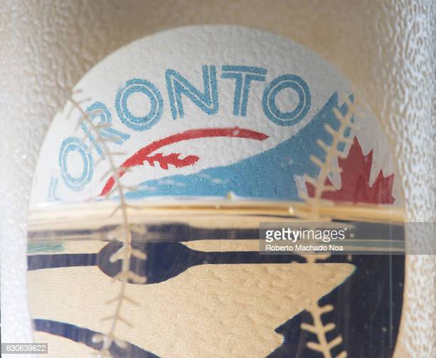 Blue Jays baseball team of the MLB celebration glass colorful Toronto brand sticker on a rugged surface it is shaped as a baseball