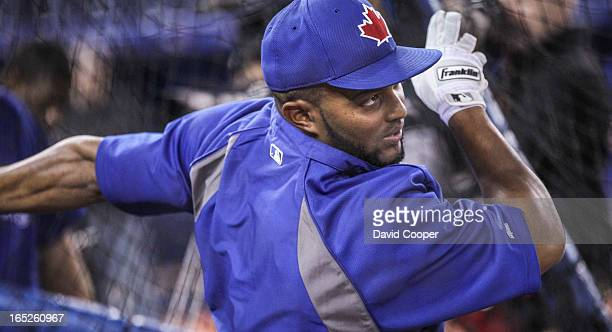 Blue Jays Emilio Bonifacio takes his turn in the cage during the team workout day at The Rogers Centre