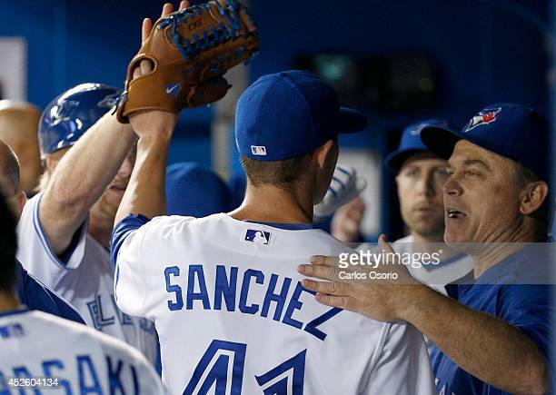 TORONTO ON JULY 23 Blue Jays pitcher Aaron Sanchez gets a pat on the back from manager John Gibbons after he pitched the 8th inning as the Toronto...
