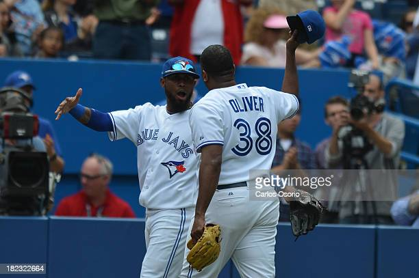 TORONTO ON SEPTEMBER 29 Blue Jays pitcher Darren Oliver is congratulated by Jose Reyes as the Toronto Blue Jays host the Tampa Bay Rays at the Rogers...