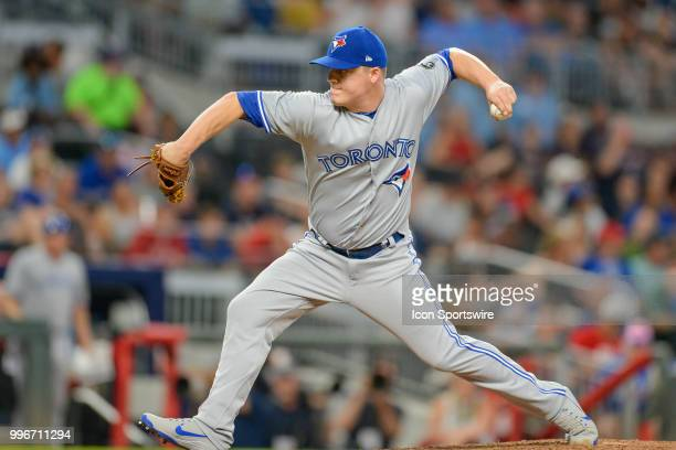 Blue Jays relief pitcher Aaron Loup throws a pitch to the plate during the game between Atlanta and Toronto on July 11th 2018 at SunTrust Park in...