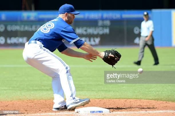 Blue Jays starter JA Happ covers the 1st base but can't make the out on Orioles' Manny Machado in the 4h inning as the Toronto Blue Jays take on the...