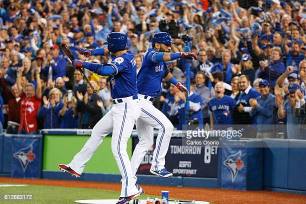 TORONTO ON OCTOBER 4 Blue Jays Troy Tulowitzki congratulates Jose Bautista after hitting a solo home run during the 2nd inning of the American League...