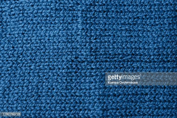 blue knitted jersey as textile background. trendy classic blue color textule as color of year 2020 concept. copy space for text and design. - knitted stock pictures, royalty-free photos & images