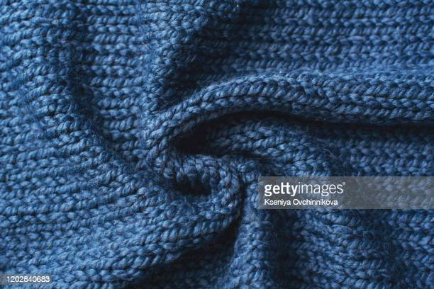 blue knitted jersey as textile background. trendy classic blue color textule as color of year 2020 concept. copy space for text and design. - セーター ストックフォトと画像