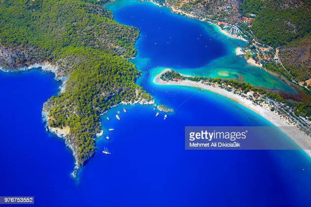 blue lagoon and green coastline, oludeniz, turkey - aegean turkey stock pictures, royalty-free photos & images