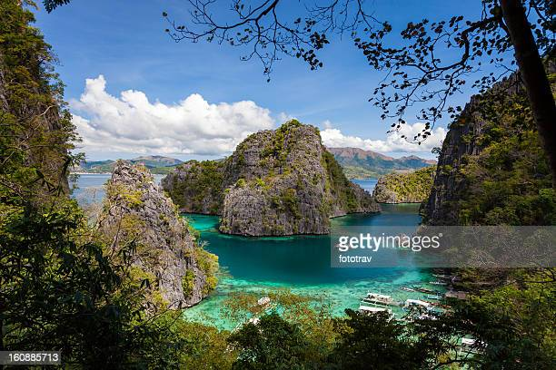 blue lagoon at kayangan lake, coron island, philippines - el nido stock pictures, royalty-free photos & images