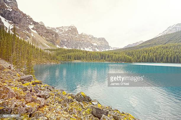 blue lake and forestland with distant mnountains
