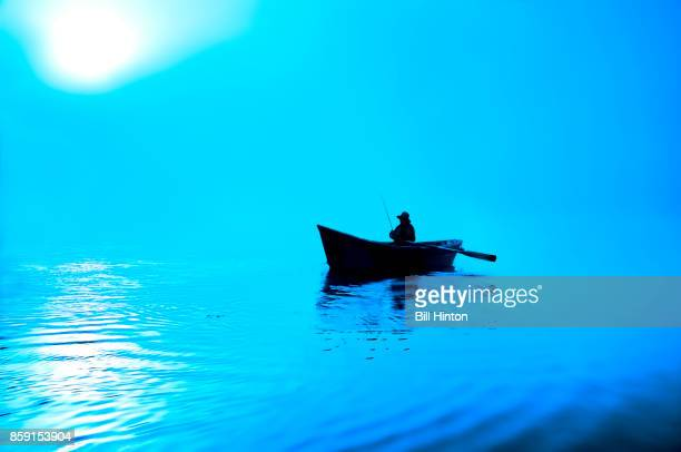 blue lake rowboat - small boat stock pictures, royalty-free photos & images