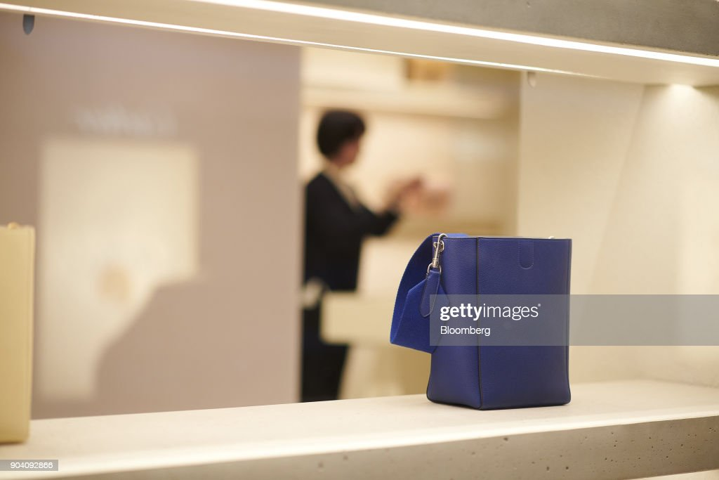 A blue leather handbag sits in the window of a Celine SA luxury goods store in Munich, Germany, on Tuesday, Jan. 9, 2018. The German economy's solid 2017 performance extended into the final three months of the year, with growth of about half a percent. Photographer: Dominik Osswald/Bloomberg via Getty Images