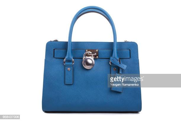 blue leather women's handbag on white background - leather purse stock pictures, royalty-free photos & images