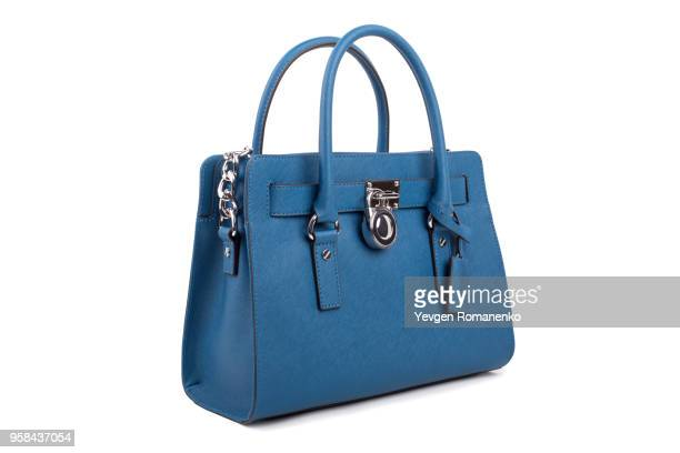 blue leather women's handbag on white background - borsetta da sera foto e immagini stock