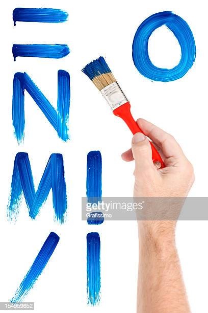 Blue letters painted with paintbrush on window