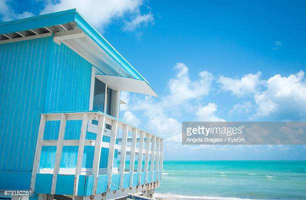 Blue Lifeguard Hut By Sea Against Sky