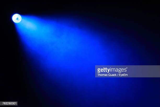 blue light against black background - projection equipment stock pictures, royalty-free photos & images