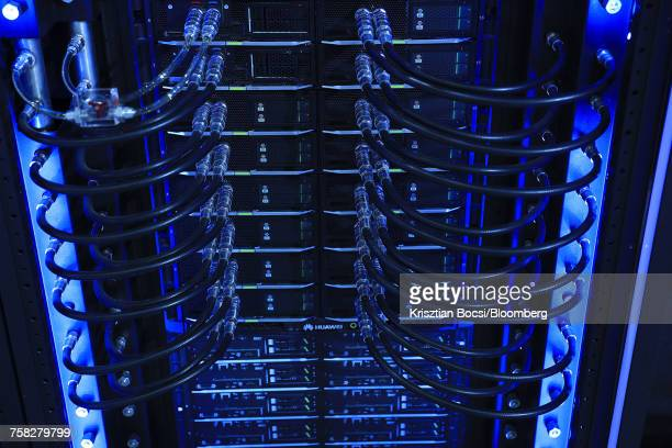 blue light illuminates cables on a blade server rack - krisztian bocsi stock pictures, royalty-free photos & images