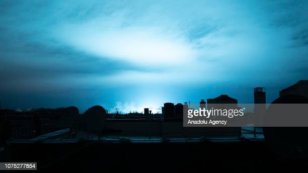 Blue light illuminates the night sky after a transformer explosion at Queens Borough in New York United States on December 27 2018
