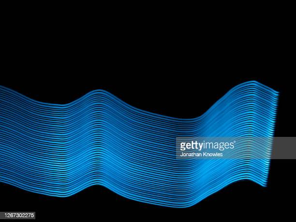 blue line pattern - light trail stock pictures, royalty-free photos & images