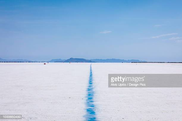 blue line showing edge of track on bonneville speedway on bonneville salt flats - bonneville salt flats stock pictures, royalty-free photos & images