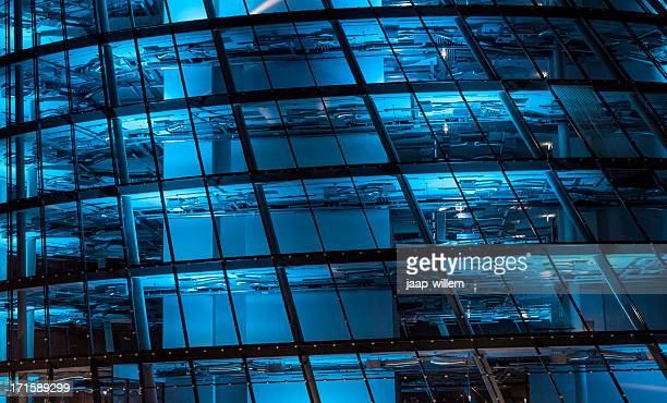 blue lit high tech office building - bank financial building stock pictures, royalty-free photos & images