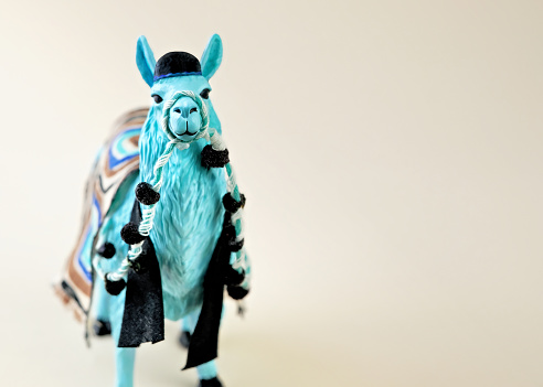 Blue llama wearing a yarmulke  and prayer shawl on neutral background with room for copy. - gettyimageskorea