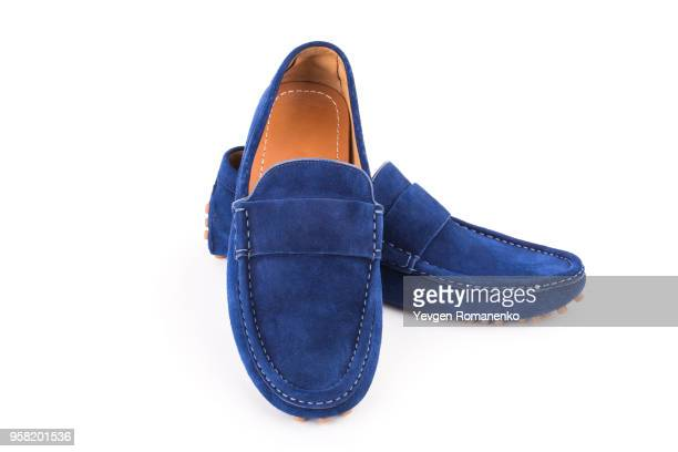 blue male suede leather loafers pair isolated on white background - suede shoe stock pictures, royalty-free photos & images