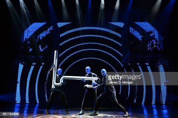 Blue Man Group Performing Live on stage with large PVC Pipe on 14th Aug 2013 in Sydney Australia